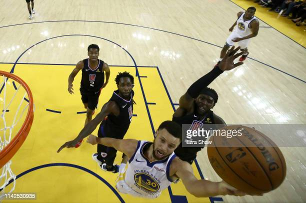 Stephen Curry of the Golden State Warriors goes up for a shot on Montrezl Harrell of the LA Clippers during Game One of the first round of the 2019...