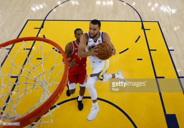 Stephen Curry of the Golden State Warriors goes up for a shot on Trevor Ariza of the Houston Rockets during Game 6 of the Western Conference Finals...