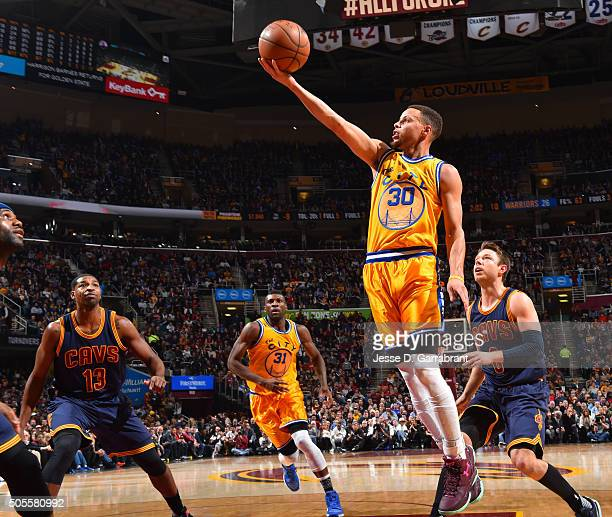 Stephen Curry of the Golden State Warriors goes up for the layup against the Cleveland Cavaliers on January 16 2016 at Quicken Loans Arena in...