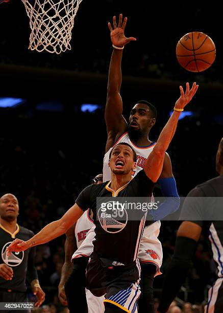 Stephen Curry of the Golden State Warriors goes up for two as Tim Hardaway Jr #5 of the New York Knicks defends at Madison Square Garden on February...