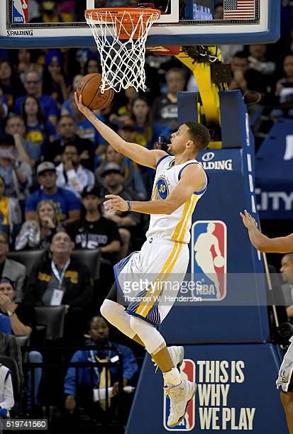 Stephen Curry of the Golden State Warriors goes up to score on a reverse layup against the San Antonio Spurs in the third quarter of an NBA...