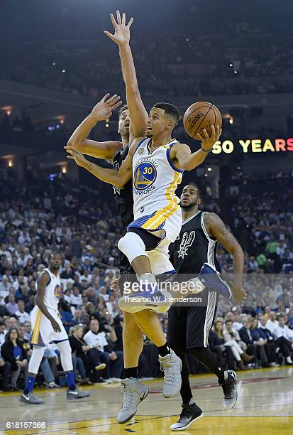 Stephen Curry of the Golden State Warriors goes up to shoot and gets fouled by Pau Gasol of the San Antonio Spurs during the first quarter in an NBA...