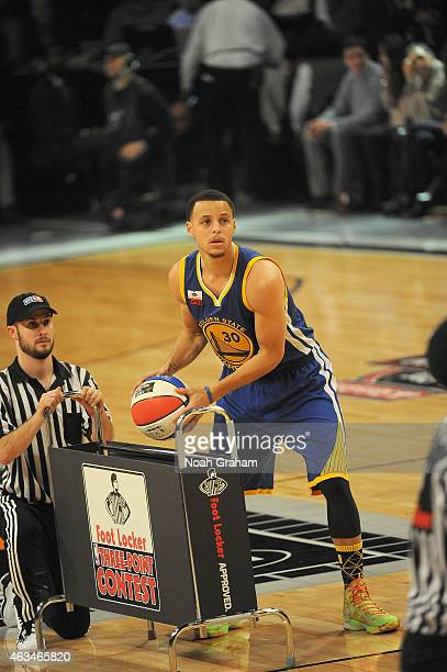 Stephen Curry of the Golden State Warriors grabs a ball from the rack during the Foot Locker Three Point Contest on State Farm AllStar Saturday Night...