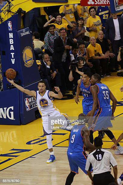 Stephen Curry of the Golden State Warriors grabs a rebound against the Oklahoma City Thunder in Game Five of the Western Conference Finals during the...