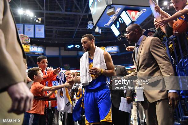 Stephen Curry of the Golden State Warriors greets children after the game against the Oklahoma City Thunder on March 20 2017 at Chesapeake Energy...