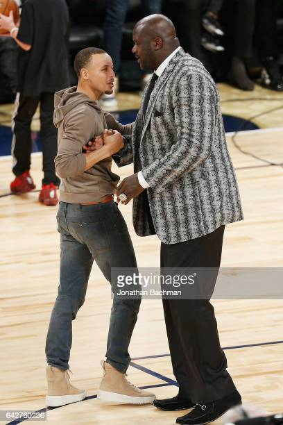 Stephen Curry of the Golden State Warriors greets Shaquille O'Neal after the 2017 JBL ThreePoint Contest at Smoothie King Center on February 18 2017...