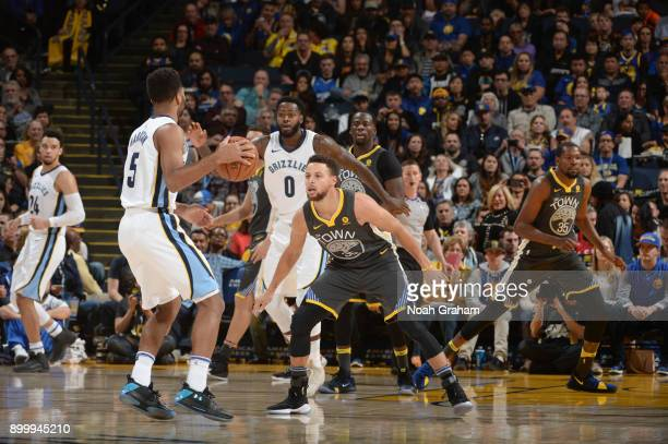 Stephen Curry of the Golden State Warriors guards Andrew Harrison of the Memphis Grizzlies on December 30 2017 at ORACLE Arena in Oakland California...