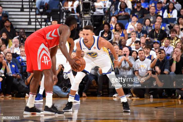 Stephen Curry of the Golden State Warriors guards James Harden of the Houston Rockets on October 17 2017 at ORACLE Arena in Oakland California NOTE...