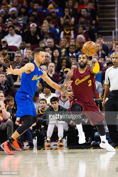 Stephen Curry of the Golden State Warriors guards Kyrie Irving of the Cleveland Cavaliers during the first half at Quicken Loans Arena on December 25...