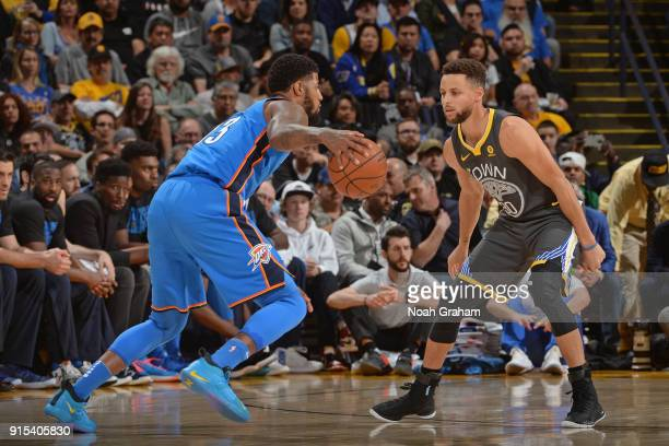 Stephen Curry of the Golden State Warriors guards Paul George of the Oklahoma City Thunder on February 6 2018 at ORACLE Arena in Oakland California...
