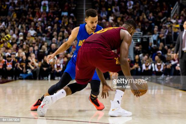 Stephen Curry of the Golden State Warriors guards Tristan Thompson of the Cleveland Cavaliers during the first half at Quicken Loans Arena on...