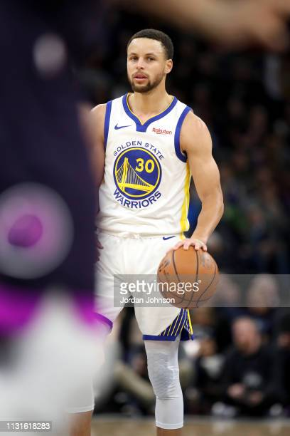 Stephen Curry of the Golden State Warriors handles the ball against the Minnesota Timberwolves on March 19 2019 at Target Center in Minneapolis...