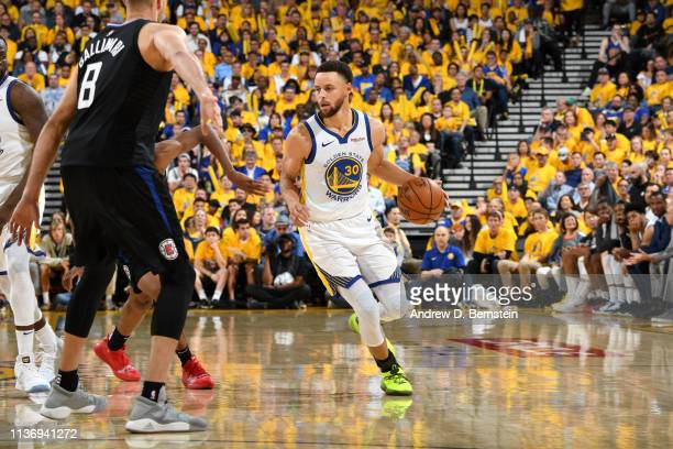 Stephen Curry of the Golden State Warriors handles the ball against the LA Clippers during Game One of Round One of the 2019 NBA Playoffs on April 13...