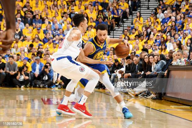 Stephen Curry of the Golden State Warriors handles the ball against the LA Clippers during Game Five of Round One of the 2019 NBA Playoffs on April...