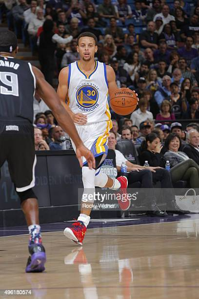 Stephen Curry of the Golden State Warriors handles the ball against the Sacramento Kings on November 7 2015 at Sleep Train Arena in Sacramento...
