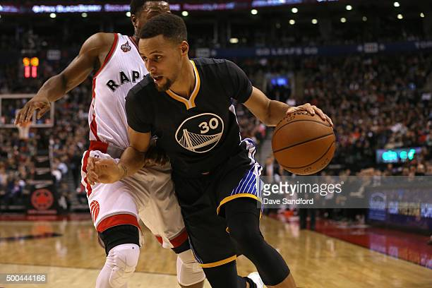 Stephen Curry of the Golden State Warriors handles the ball against the Toronto Raptors on December 5 2015 at Air Canada Centre in Toronto Ontario...