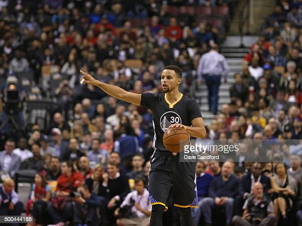 Stephen Curry of the Golden State Warriors handles the ball against the Toronto Raptors December 5 2015 at Air Canada Centre in Toronto Ontario...