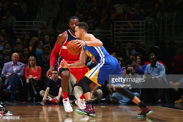 Stephen Curry of the Golden State Warriors handles the ball against the Washington Wizards on February 3 2016 at Verizon Center in Washington DC NOTE...