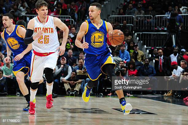 Stephen Curry of the Golden State Warriors handles the ball against Kyle Korver of the Atlanta Hawks on February 22 2016 at Philips Center in Atlanta...