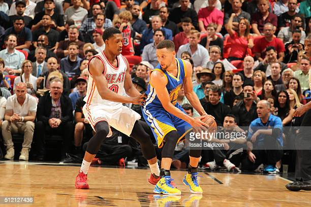 Stephen Curry of the Golden State Warriors handles the ball against Josh Richardson of the Miami Heat on February 24 2016 at American Airlines Arena...