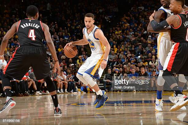 Stephen Curry of the Golden State Warriors handles the ball against Maurice Harkless of the Portland Trail Blazers on March 11 2016 at Oracle Arena...