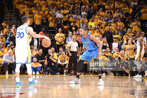Stephen Curry of the Golden State Warriors handles the ball against Kevin Durant of the Oklahoma City Thunder in Game Five of the Western Conference...