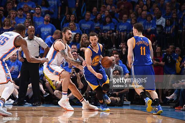 Stephen Curry of the Golden State Warriors handles the ball against Steven Adams of the Oklahoma City Thunder in Game Six of the Western Conference...
