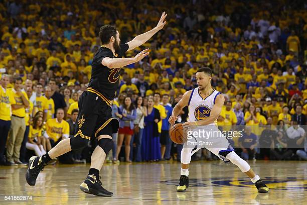 Stephen Curry of the Golden State Warriors handles the ball against Kevin Love of the Cleveland Cavaliers during the second half in Game 7 of the...
