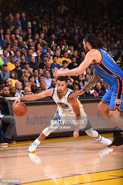 Stephen Curry of the Golden State Warriors handles the ball against Steven Adams of the Oklahoma City Thunder during a game on November 3 2016 at...