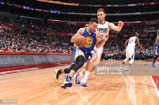Stephen Curry of the Golden State Warriors handles the ball against the LA Clippers on December 7 2016 at STAPLES Center in Los Angeles California...