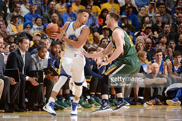 Stephen Curry of the Golden State Warriors handles the ball against the Utah Jazz on December 20 2016 at ORACLE Arena in Oakland California NOTE TO...