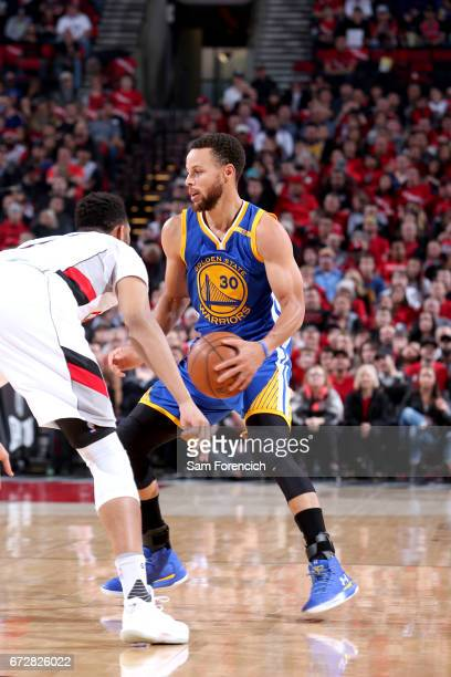 Stephen Curry of the Golden State Warriors handles the ball against the Portland Trail Blazers during Game Four of the Western Conference...