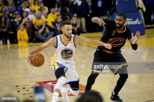 Stephen Curry of the Golden State Warriors handles the ball against Kyrie Irving of the Cleveland Cavaliers in Game Five of the 2017 NBA Finals on...