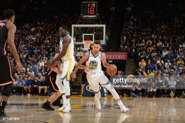 Stephen Curry of the Golden State Warriors handles the ball against the Miami Heat on November 6 2017 at ORACLE Arena in Oakland California NOTE TO...