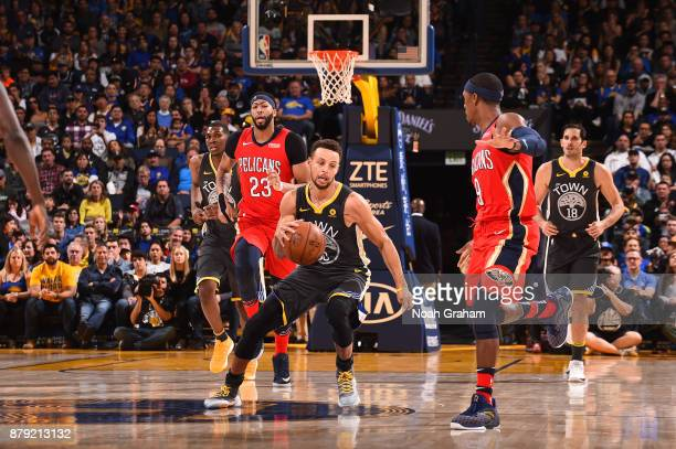 Stephen Curry of the Golden State Warriors handles the ball against the New Orleans Pelicans on November 25 2017 at ORACLE Arena in Oakland...
