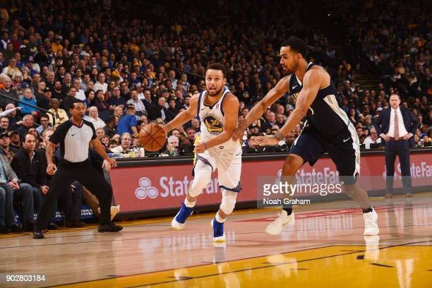 Stephen Curry of the Golden State Warriors handles the ball against the Denver Nuggets on January 8 2018 at ORACLE Arena in Oakland California NOTE...