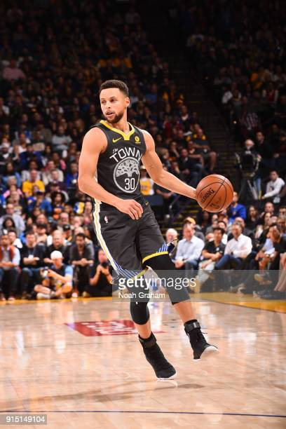 Stephen Curry of the Golden State Warriors handles the ball against the Oklahoma City Thunder on February 6 2018 at ORACLE Arena in Oakland...