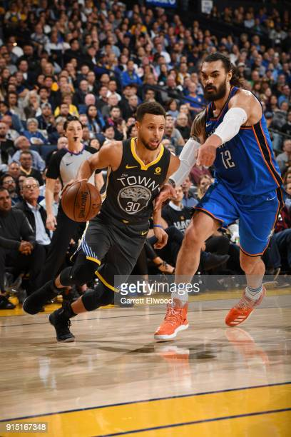 Stephen Curry of the Golden State Warriors handles the ball against Steven Adams of the Oklahoma City Thunder on February 6 2018 at ORACLE Arena in...