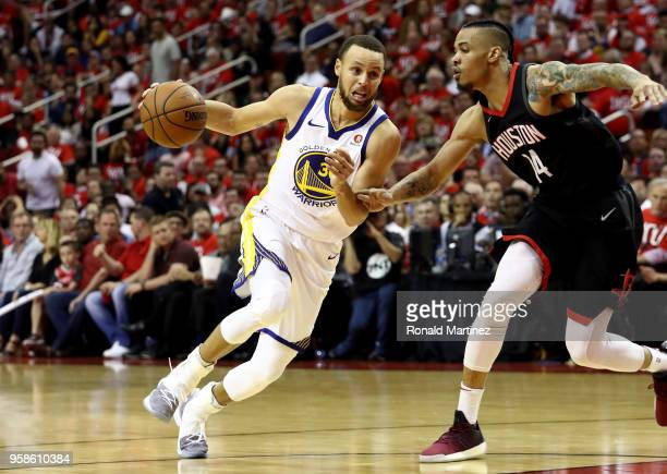 Stephen Curry of the Golden State Warriors handles the ball against Gerald Green of the Houston Rockets in the second half in Game One of the Western...