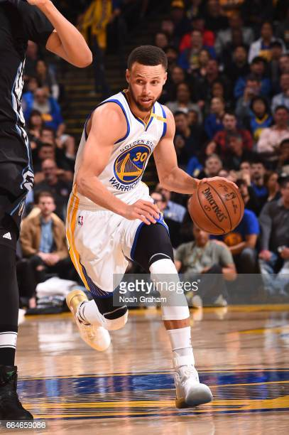 Stephen Curry of the Golden State Warriors handles the ball during a game against the Minnesota Timberwolves on April 4 2017 at ORACLE Arena in...