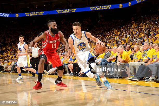 Stephen Curry of the Golden State Warriors handles the ball during the game against James Harden of the Houston Rockets in Game One of the Western...