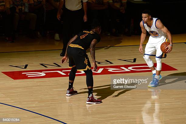 Stephen Curry of the Golden State Warriors handles the ball during the game against Iman Shumpert of the Cleveland Cavaliers during Game Five of the...