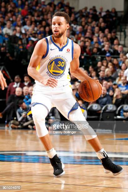 Stephen Curry of the Golden State Warriors handles the ball during the game against the Dallas Mavericks on January 3 2018 at the American Airlines...