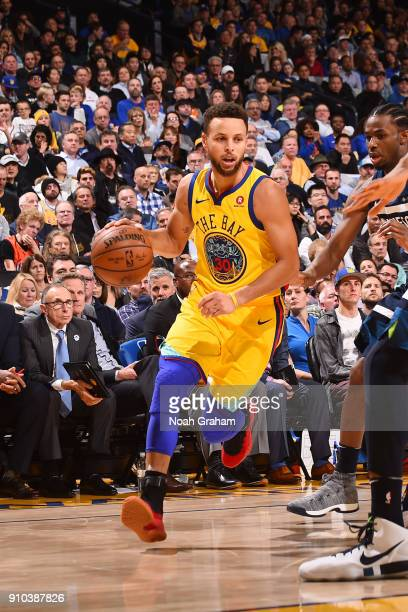 Stephen Curry of the Golden State Warriors handles the ball during the game against the Minnesota Timberwolves on January 25 2018 at ORACLE Arena in...