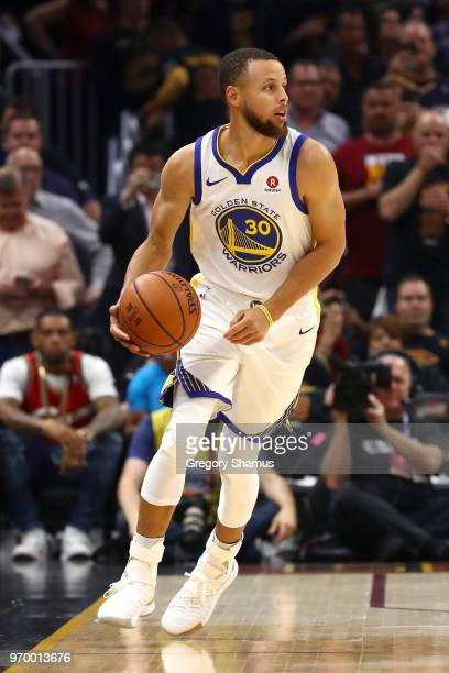 Stephen Curry of the Golden State Warriors handles the ball in the first quarter against the Cleveland Cavaliers during Game Four of the 2018 NBA...