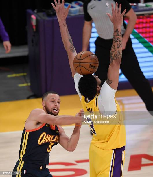 Stephen Curry of the Golden State Warriors has a pass blocked by Anthony Davis of the Los Angeles Lakers in the closing seconds of the NBA Play-In...