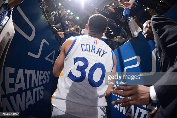 Stephen Curry of the Golden State Warriors heads to the locker room after defeating the Miami Heat on January 11 2016 at Oracle Arena in Oakland...