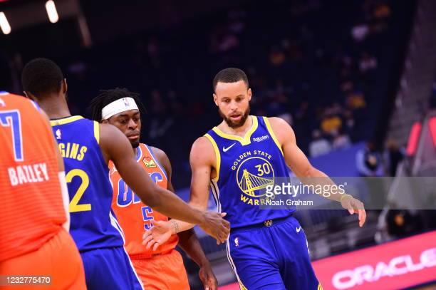 Stephen Curry of the Golden State Warriors high fives Andrew Wiggins of the Golden State Warriors during the game against the Oklahoma City Thunder...
