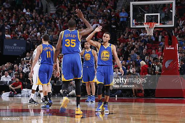Stephen Curry of the Golden State Warriors high fives Kevin Durant during the game against the Portland Trail Blazers on November 1 2016 at the Moda...