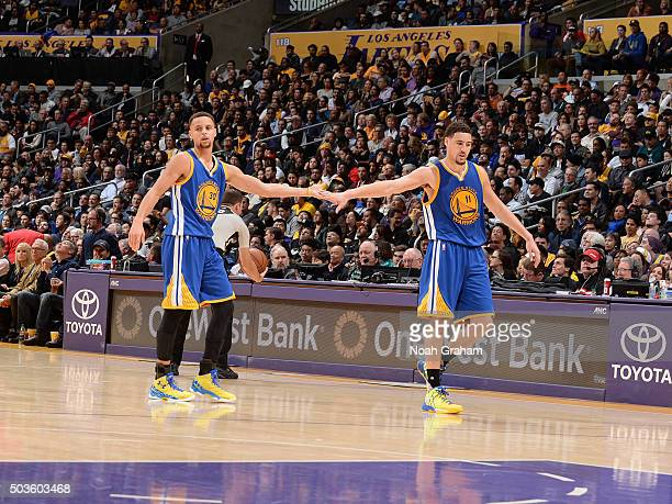 Stephen Curry of the Golden State Warriors high fives Klay Thompson during the game against the Los Angeles Lakers at STAPLES Center on January 05...